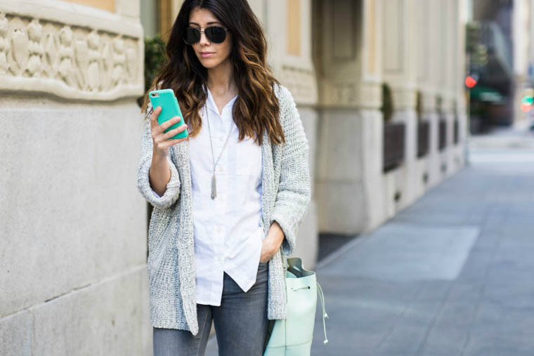 White top, grey jeans, mint bag