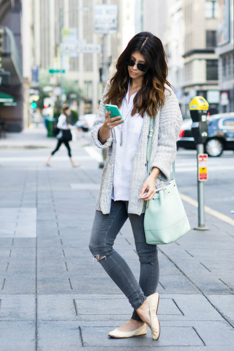 grey jeans, nude flats, mint bag