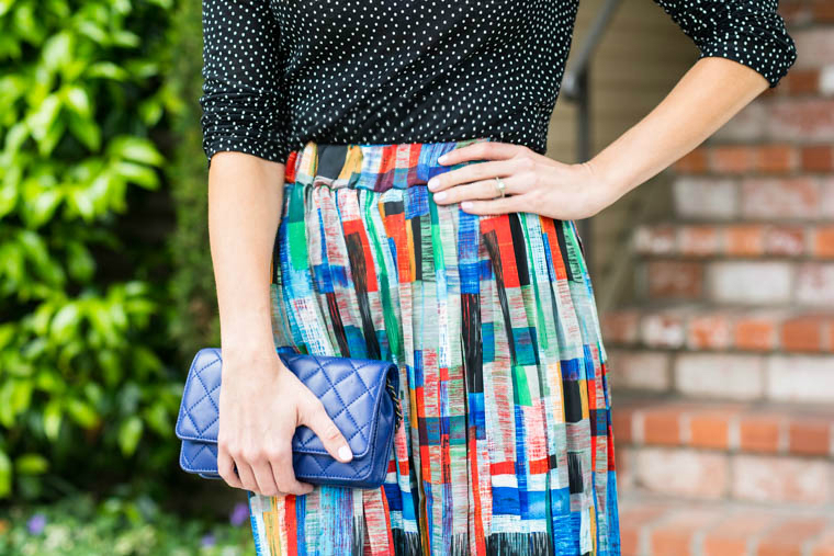 Colorful stripes, polka dots, blue clutch