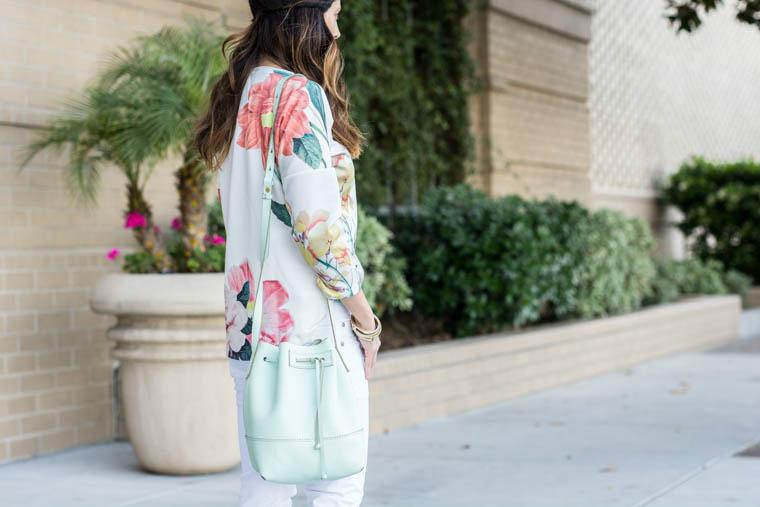 Floral top, mint bag, white jeans