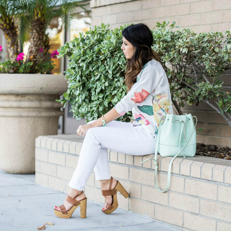 Floral top, white jeans, wedges