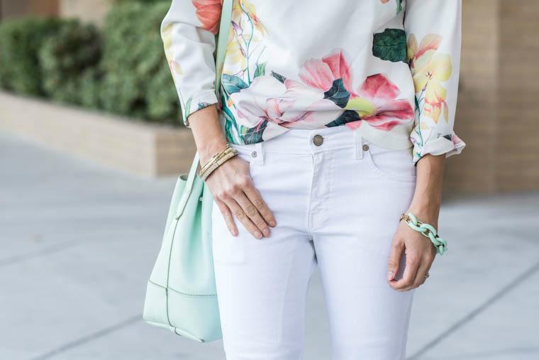 White jeans, floral top, mint bucket bag