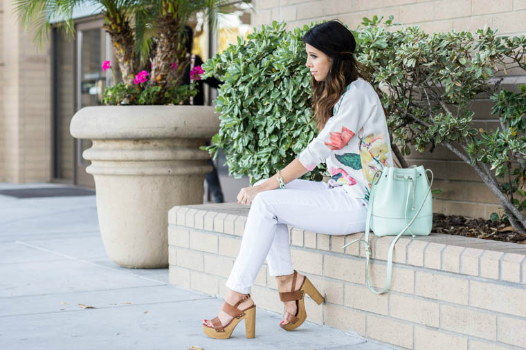 White pants, floral top, wedges