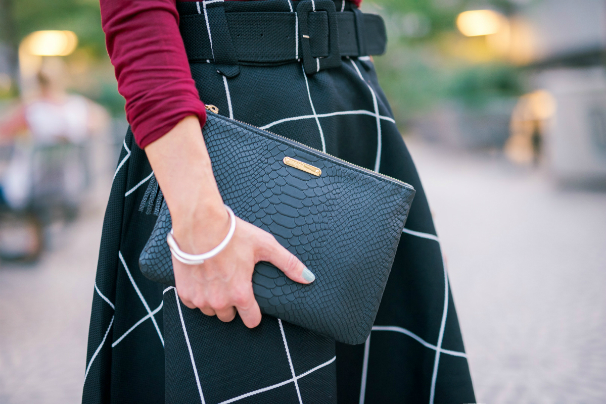 The Girl in the Yellow Dress, Black Clutch