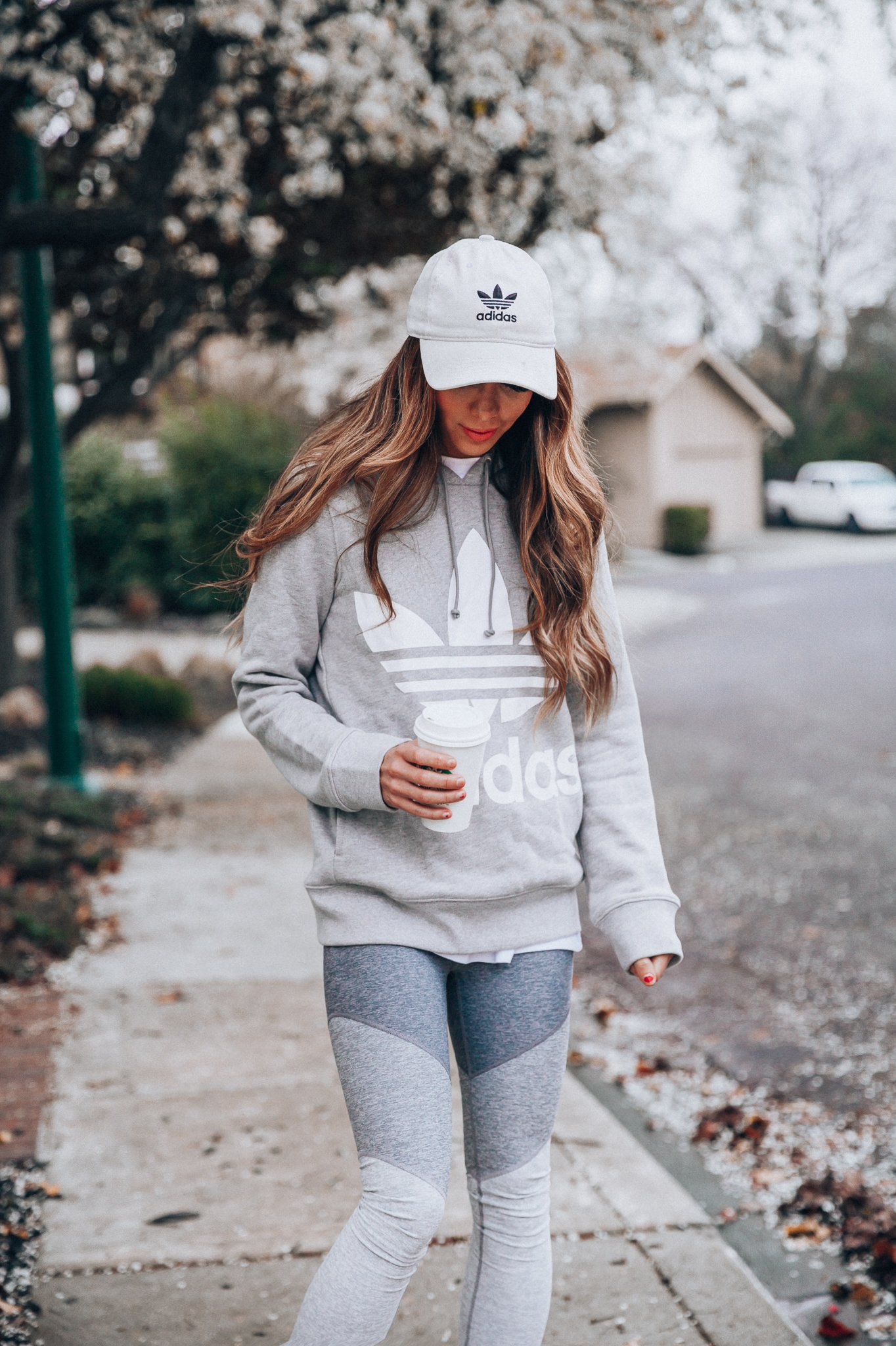 Workout Plan for Busy Moms featured by top US life and style blog The Girl in the Yellow Dress; Image of the woman wearing Adidas hat, Adidas sweater, Outdoor Voices leggings and Halogen sneakers.